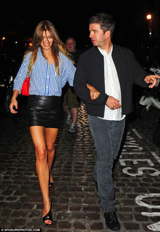 Date night: Former Oasis rocker Noel Gallagher and his wife Sara MacDonald left the Chiltern Firehouse in London arm-in-arm on Thursday night