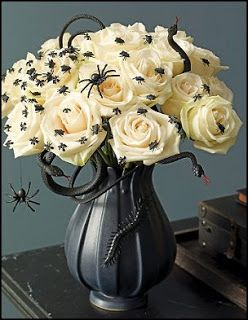 Buy flowers and let them dry out. Cover in fake webbing and spiders for old creepy look