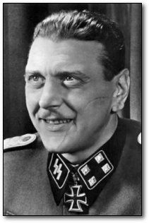 """Otto Skorzeny - Led the commando operation that rescued Benito Mussolini from capture, headed a plot to assassinate FDR, Churchill and Stalin and was a key player in a commando operation that operated behind Allied lines a full year after Germany's surrender. After the war, Skorzeny escaped from his military tribunal, he went into hiding in Spain, where he spearheaded the ODESSA Network (a """"Fourth Reich""""). In the 1970s, Skorzeny formed the Paladin Group (the real life Cobra Command)."""
