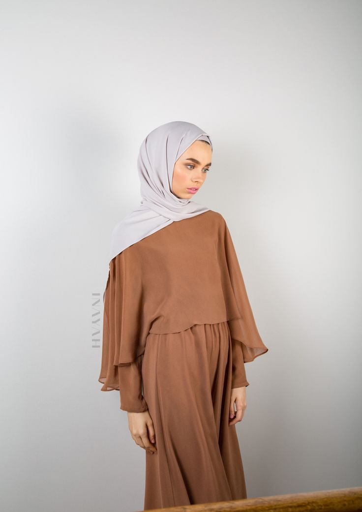 The Soft Cinnamon Cape Maxi Dress is effortlessly elegant. Made from billowy chiffon, its floor-sweeping silhouette and cape-style back and front ripples as you move. Soft Cinnamon Cape Maxi #Dress + Feather Grey Rayon #Hijab. - www.inayah.co
