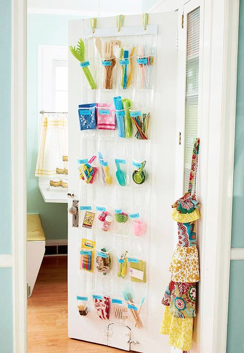 Use a shoe organizer on the inside of your pantry for small kitchen utensils!      Get a great deal on shoe organizers at Old Time Pottery!    http://www.oldtimepottery.com/