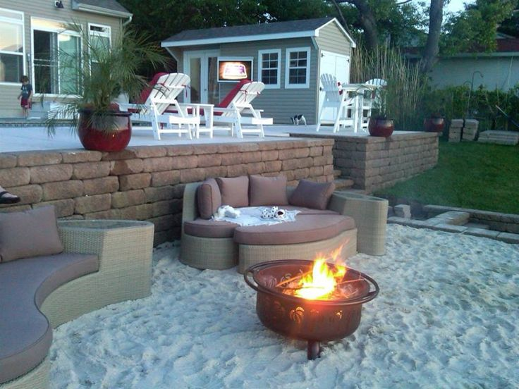 Cool sand around fire-pit at the beach.