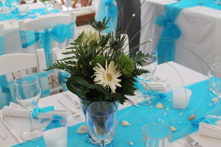Lefkas Weddings L&W Wedding at Seaside Restaurant Lefkada. Turquoise theme wedding with white gerbera vases