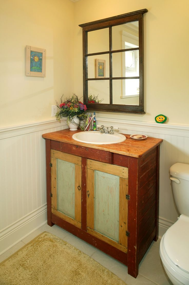 Rustic Vanity White Baseboard Yellow Walls Dark Wood Mirror Frame Wood Countertops In A Warm