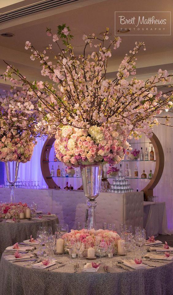 Unique luxury pink floral wedding reception centerpiece; Featured Photographer: Brett Matthews Photography