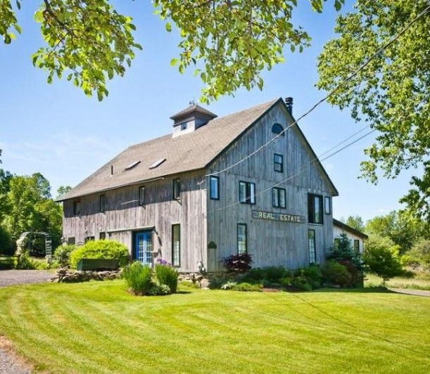 1872 post and beam barn that was restored and transformed into a 4,200 square-foot home. It sits on nearly 13 scenic acres in Isleboro, Maine