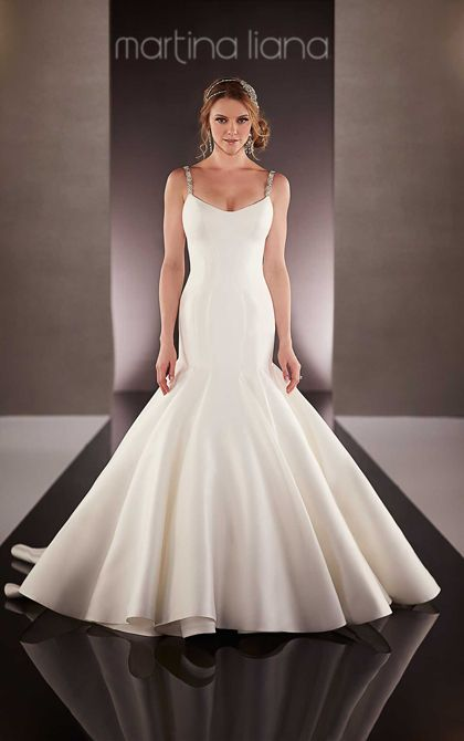 "An impressive 600"" hemline, fabric -covered buttons, and Swarovski crystal straps complete the dramatic, high-fashion look of this modern fit-and-flare bridal gown from the Martina Liana wedding dress collection. Choose from five luxurious fabrics and five romantic color combinations."