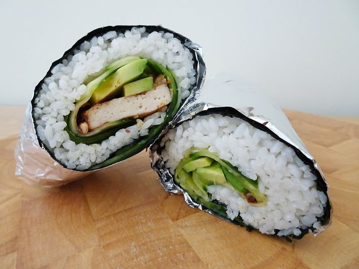 Mega sushi burrito stuffed with cucumber, avocado and delicious sweet and spicy baked tofu. Suitable for vegetarians/vegans.