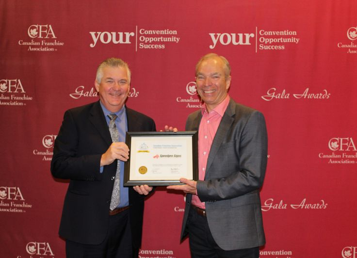 Speedpro Canada President, Stuart Burns, accepting the 'Franchisees' Choice Designation' for the 5th straight year at the CFA National Convention from John Wissent, Chair of the CFA Board of Directors!