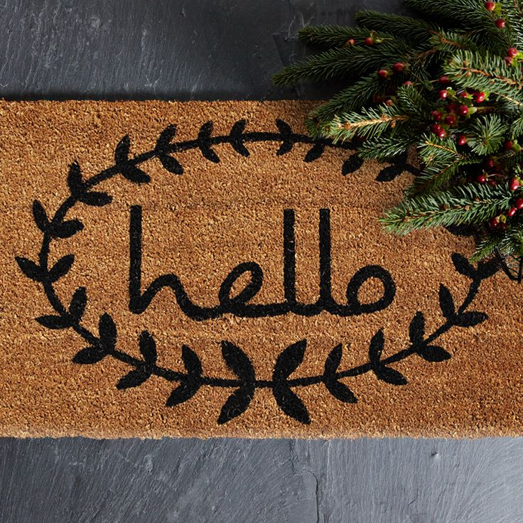 Extend A Warm Greeting To Your Guests With This Lovely Coir Doormat,  Featuring A Vine Border And Retro Inspired Text Print.