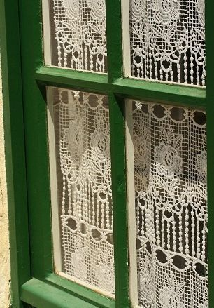 lovely lace curtains..........A Positively Beautiful Blog