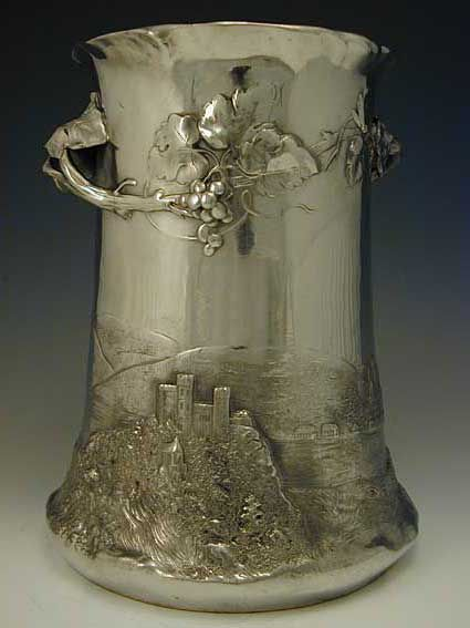 [view # 2] Polished pewter champagne bucket with figural Art Nouveau maiden