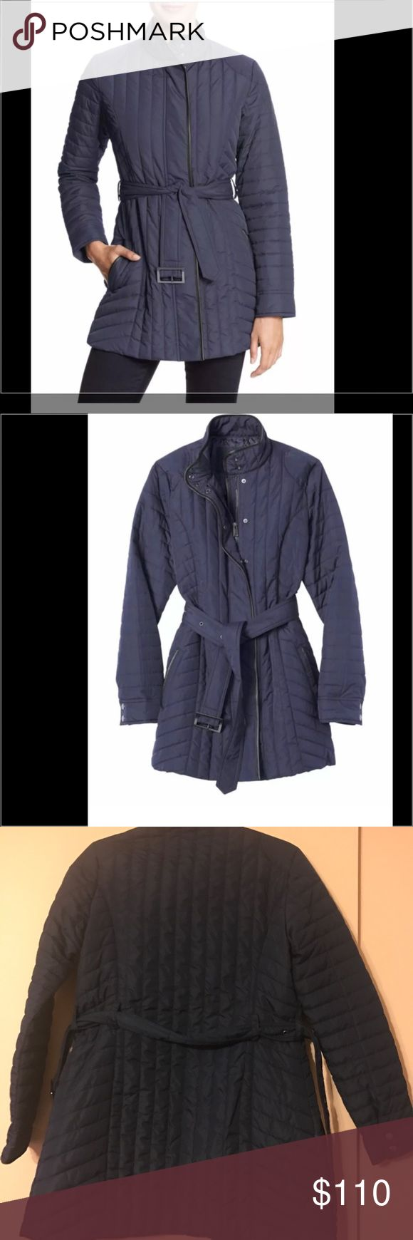 Banana Republic Women's Quilted Coat Evening Blue Imported. Hidden zipper with snap placket. Adjustable buckle belt. 100% polyester. Machine wash. Standing collar with snap closure. Banana Republic Jackets & Coats