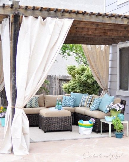 25 DIYs for a Summer Patio Makeover // aqua throw pillows and accents // L shaped outdoor sofa // beige curtains