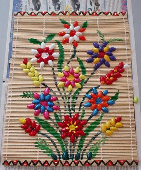 things with shells this wall hanging using pista shells a table mat and fabric paint shells pinterest shell crafts crafts and pistachio shells