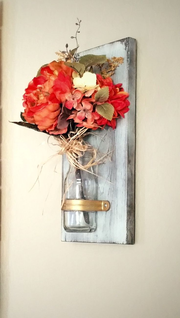 white distressed wood wall vase with gold and vintage milk bottle vase