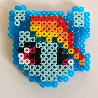 Free My Little Pony perler bead patterns for perler, hama, nabbi and pyssla crafting. Image shows a Finished Rainbow Dash front.
