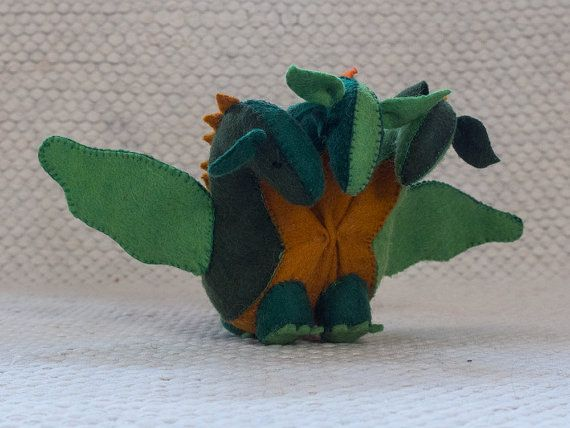 Waldorf dragon Felt dragon  This wonderful green felt dragon with three head is made of 100% eco felt and stuffed with high quality wool. It has a unique