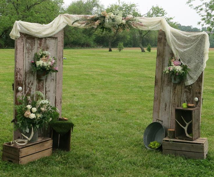 Gorgeous rustic spring wedding entry doors, designed by Jen-Mor Florist in Dover, DE www.jenmor.com