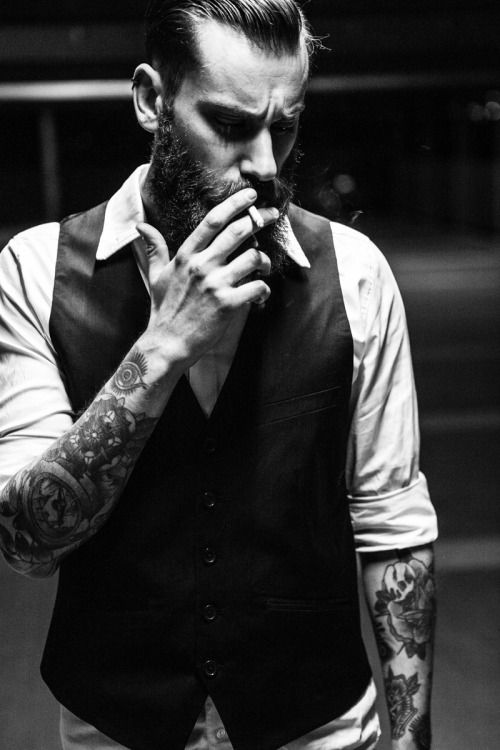 Suits, waistcoats and arm tattoos.