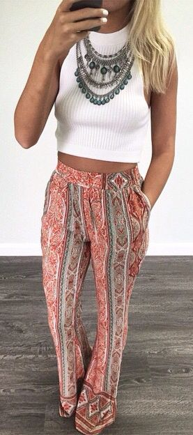 this outfit is soo cute. the statement necklace and the tribal pink pant add that Coachella vibes while still keeping it casual with a white top.