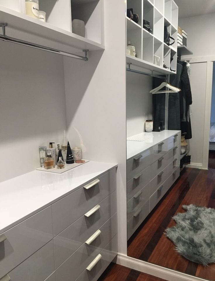 A Dream Elite Walk In Robe by The Wardrobe Man. Close up on Drawer Boxes and Long hang in mirror reflection.