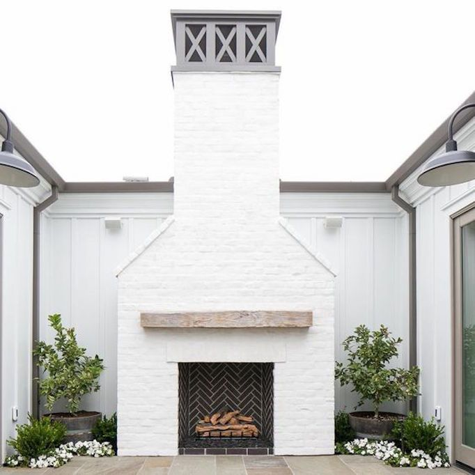 Beautiful A Wood Burning Outdoor Fireplace With Reclaimed Wood Mantel And Beautiful  Chevron Patterned Box