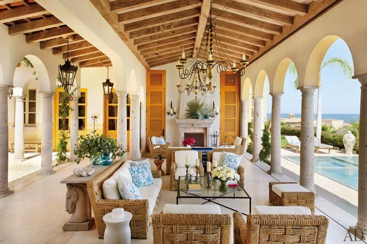 Tuscan columns of cantera stone frame the Cabana Living Room in this Mexican vacation villa