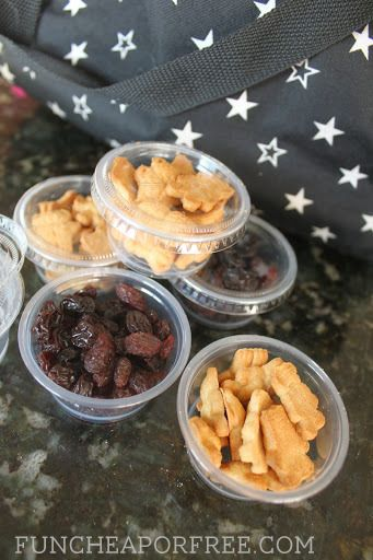 Use cheap condiment cups to pack snacks. They are so cheap and work great! You can find them at Walmart in the paper plate aisle. Tons more tips for traveling with kids! #travel