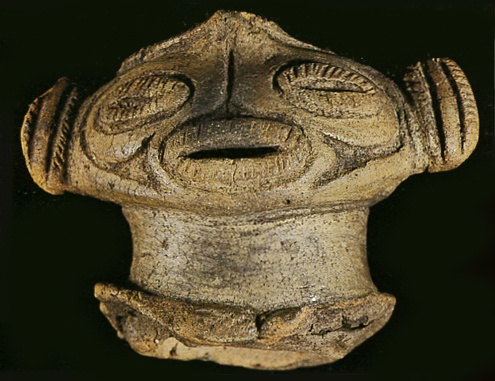 "The Dogu that only the head was excavated. Japanese ceramic figurine ""DOGU"".   Jomon-era. Hokkaido Japan. BC.1,200 - BC.800."