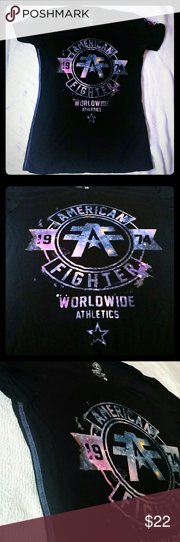 BUCKLE XL American Fighter Black Galaxy T- Shirt Women's American Fighter Tee Size XL Designed exclusively for BUCKLE. Black with galaxy/ space styled logo. Excellent condition! From a smoke-free and pet-free home. American Fighter Tops Tees - Short Sleeve