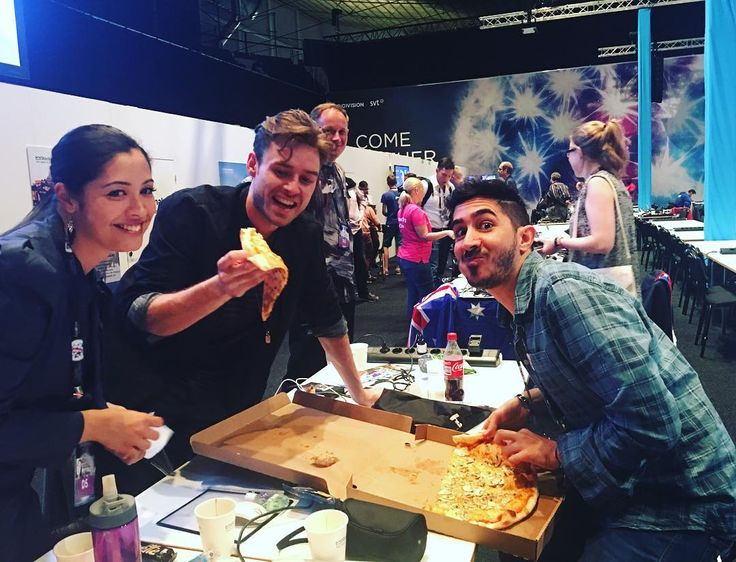 When you finally get a chance to eat in the press centre.. And the artists are Hungry too. Johannes @joe_ny #Lighthousex  takes a slice of my pizza.  Eurovisionmemories! by ahmadhalloun