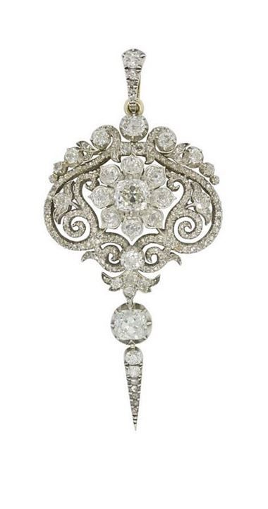 A fine early Victorian diamond pendant, the pendant delicately set with a central floral cluster, to the centre of an ornate openwork scroll-design plaque, encrusted throughout with old brilliant- and rose-cut diamonds, with old brilliant-cut diamond drop, circa 1840.
