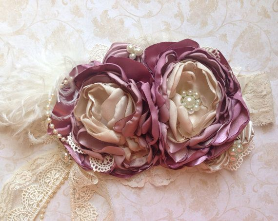*Please allow 2-3 weeks for processing (not including shipping) rush orders available* *Please read shop announcement for current policies* Gorgeous colors of deep mauve, light mauve, cream and ivory! With beautiful lace and pearl accents, and a beautiful lace bow hanging down to give it a unique touch. This is a very large over the top headband, but so fun and gorgeous for pictures! Each flower is about 4-5 diameter, and is on a 2 lace elastic headband. Can be made petite (about 3…