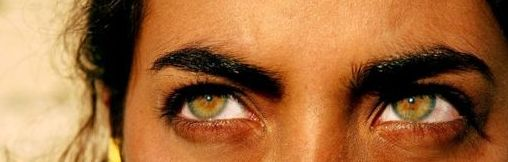 Lovely eyes to contrast the dark skin and dark hair.