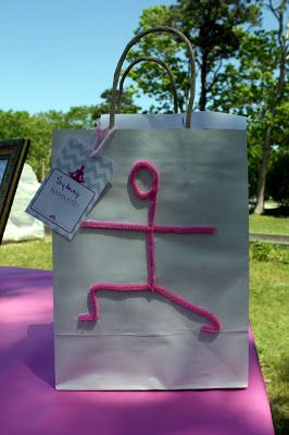I took pink pipe cleaners and a glue gun and made yoga goody bags for the little yogis