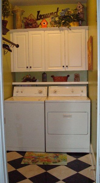 Cabinets and shelf over washer and dryer