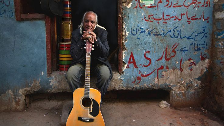Asad Ali, 63, was unemployed for four years when Pakistan banned live music in 1977. He now plays the guitar for Sachal Studios Orchestra around the globe and in his hometown, Lahore.