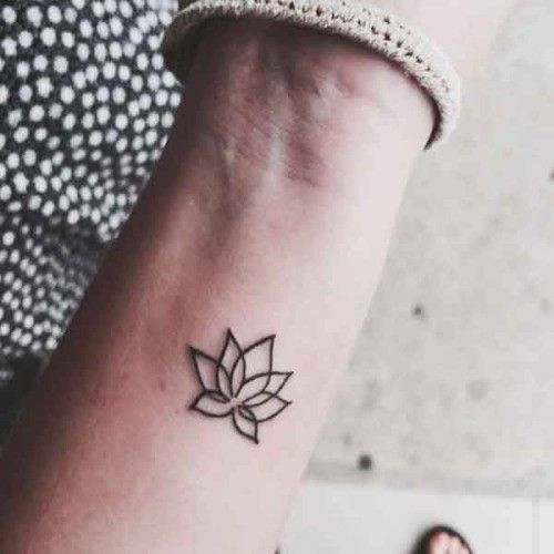 Tender small lotus flower tattoo on wrist