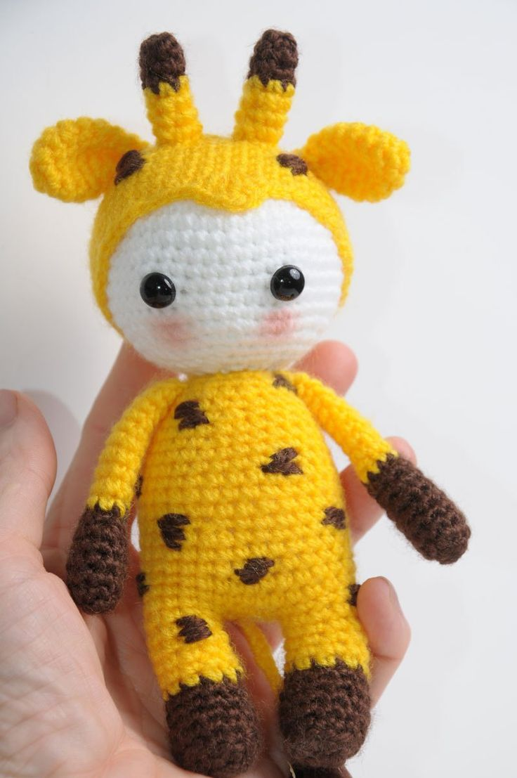 Amigurumi pop in giraffe kostuum