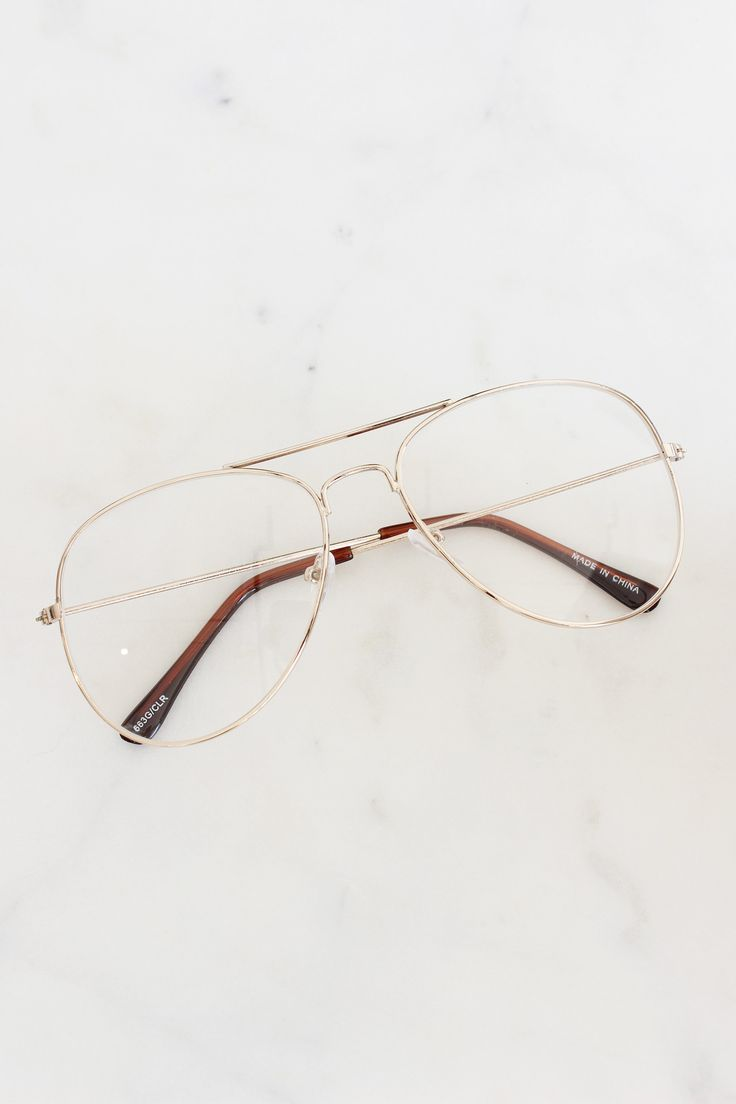 Clear aviator lenses with gold frame.