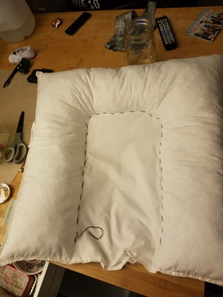 IKEA throw pillow into Baby nest Dock a