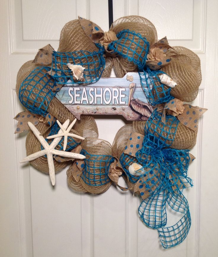 """Seaside Welcome Wreath: Bring the delights of the sea to your home. This 20"""" burlap deco-mesh wreath on a wire frame features turquoise net ribbon, shells and starfish. Whether you live by the ocean or in the 'burbs, this wreath is a lovely, summertime welcome!"""