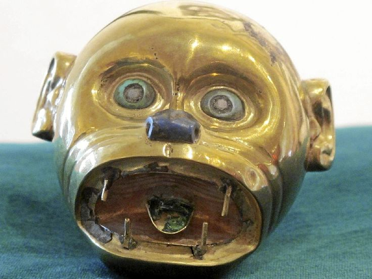 pre colombian Moche culture (ca. 100-800 AD) monkey head  1.75 by 2.25 inches  gold, turquoise and shell eyes,  turquoise tongue, Lapis Lazuli nose.