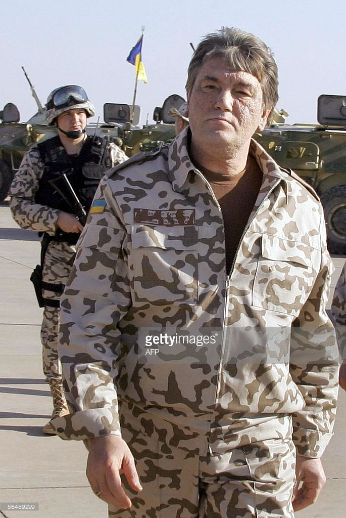 President of Ukraine Viktor Yushchenko visits a military base near the Shiite city of Kut, where Ukrainian troops have been stationed, 26 December 2005. Ukraine President Viktor Yushchenko arrived in Iraq on Monday for a surprise visit, as Ukraine wrapped up a withdrawal of most of its troops from the country. Yushchenko ordered Ukraine's troops out of the country earlier this year after assuming power in the ex-Soviet country following last year's 'orange revolution.'