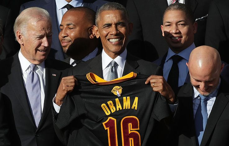WASHINGTON, DC - NOVEMBER 10: U.S. President Barack Obama and Vice President Joseph Biden pose for photos with head coach Tyronn Lue and other members of the Cleveland Cavaliers during a South Lawn event November 10, 2016 at the White House in Washington, DC. President Obama hosted the Cavaliers to honor their 2016 NBA championship.
