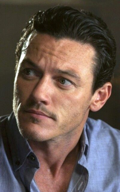 Luke Evans. His face is so strong yet it can still be soft. And his smile... I could go on for a while