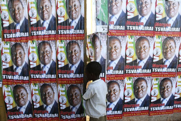 ANOTHER CHOICE: A child stood near a wall of posters of presidential candidate Morgan Tsvangirai in Harare, Zimbabwe, Tuesday, a day before the election that will pit Mr. Tsvangirai against incumbent Robert Mugabe. The longtime president denied that his supporters had rigged prior elections. (Tsvangirayi Mukwazhi/Associated Press)