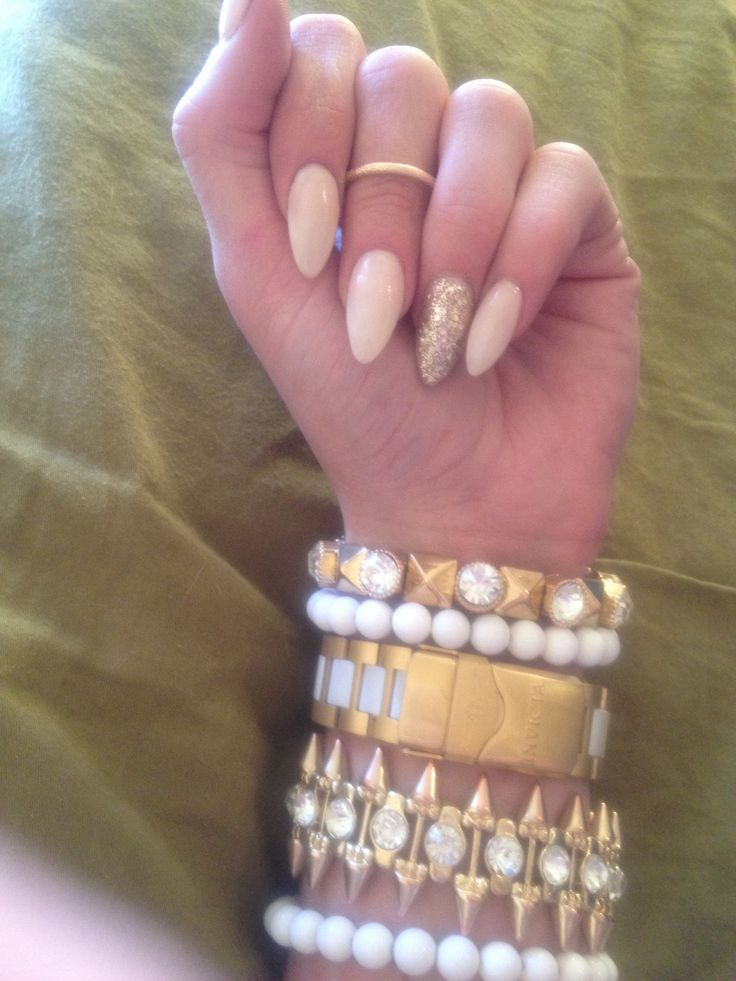 Nude and gold almond shape nails