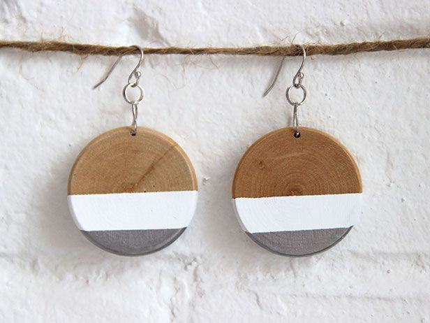 Use some wooden disks and ball hook wire earrings from a craft store, plus painter's tape, acrylic paint, and some silver gilding liquid, to make these stunning DIY earrings.